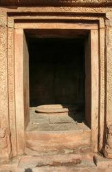 A vertical shot of a red stone door of lower Shivalaya temple in Badami, Karnataka, India