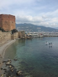 A vertical shot of a resort city Alanya with a historical medieval fortress in Turkey