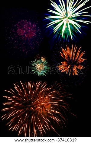 A vertical shot of fireworks in a nighttime sky
