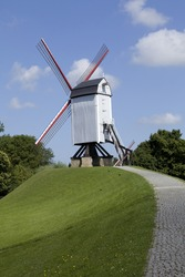 A vertical shot of one of the windmills in Bruges Brugges in Belgium, Europe.