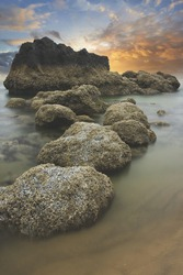 A vertical shot of rock formations at the Cannon beach in Oregon