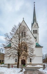 A vertical shot of the facade of the St  Martin's Parish Church in Bled, northwestern Slovenia