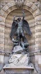 A vertical shot of the Fontaine Saint-Michel in Paris