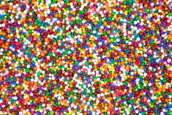 A very close view of colorful candy sprinkles.
