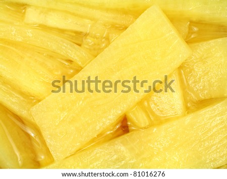 A very close view of sliced canned bamboo shoots.