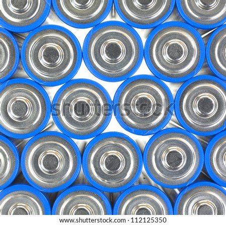 A very close view of the positive end of AA sized batteries.