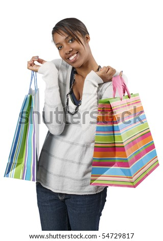 A very happy shopaholic girl holding bags and smiling wildly about her rabid consumerism.