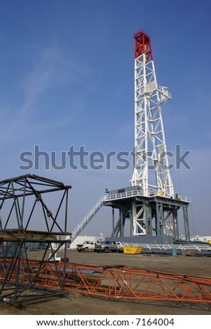 A very large oil well drilling rig sets up in kern County, California