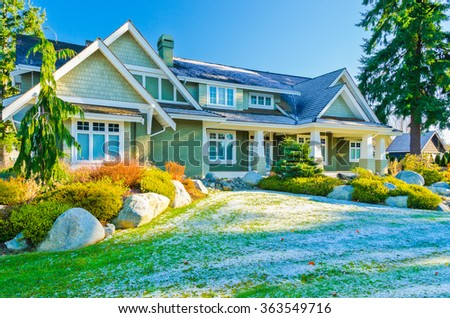 a very neat and tidy home with gorgeous outdoor landscape covered with snow patches at winter day in suburbs of Vancouver, Canada