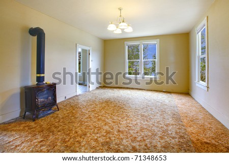 A very old empty living  room with yellow walls. Build in 1907 old farm house in Ashford, Washington State near Mt. Rainier.