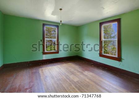A very old empty room with bright green walls. Build in 1907 old farm house in Ashford, Washington State near Mt. Rainier. - stock photo