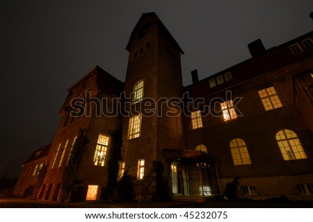 A very old haunted house at night