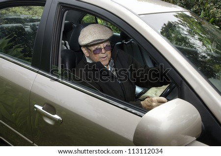 A very old man with a valid driving license drives his car.