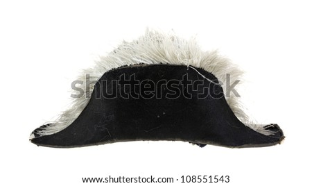 A very old military black felt dress hat with feathers on a white background.