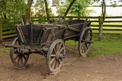 A very old peasant horse wooden cart on a polish agricultural farm.
