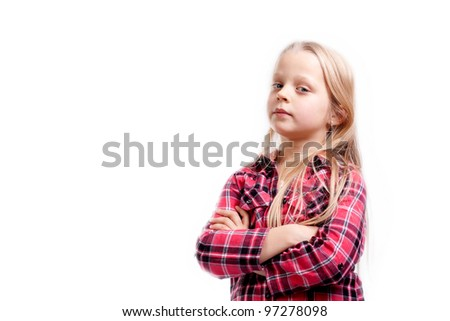 a very serious little girl on white background
