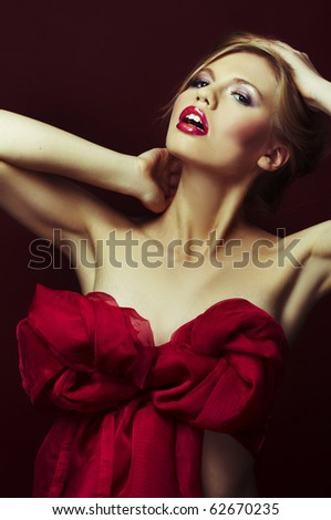 a very sexy blond girl on red background