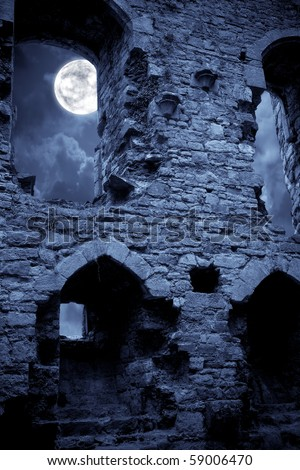 A very spooky Halloween castle in the moonlight - stock photo