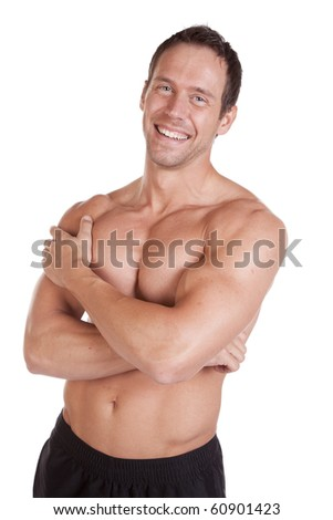 A very strong man is standing arms crossed and smiling. - stock photo