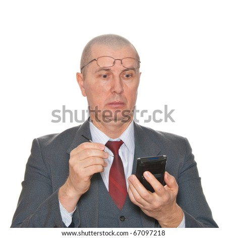 A very suprised businessman with pda isolated on white.