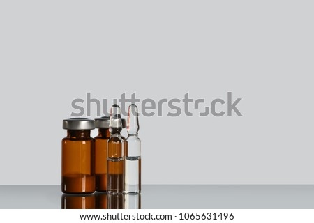 A vial (ampoule, container) with a drug (medicine powder) on a white background. #1065631496