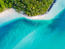 A vibrant aerial view of the beach