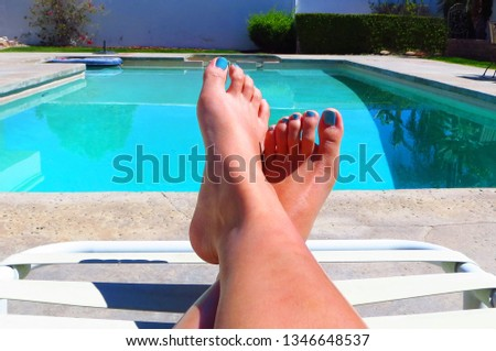 A vibrant pic of some pedicured feet relaxing poolside. Spring break vibes, relaxation, and vacation.  #1346648537