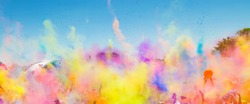 A vibrant shot of people celebrating Holi (Festival of colors) in South Africa