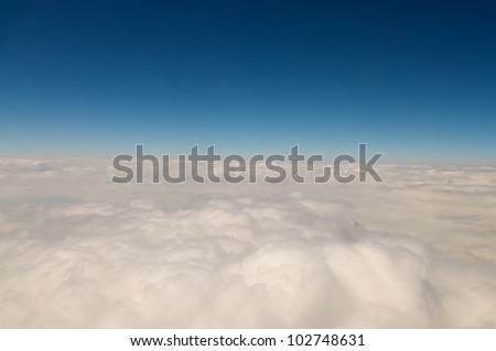 A view above the clouds from an airplane