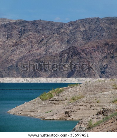 a view across lake mead near las vegas nevada check out the water line on the far side stock. Black Bedroom Furniture Sets. Home Design Ideas