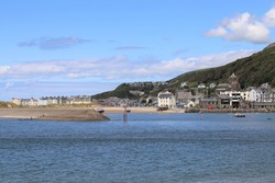 A view across the Mawddach estuary to Barmouth in Gwynedd, Wales, UK.