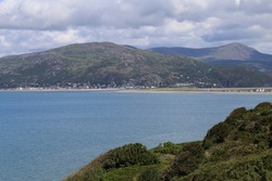 A view across the mouth of the Mawddach River past Fairbourne to Barmouth,  Gwynedd, Wales, UK.
