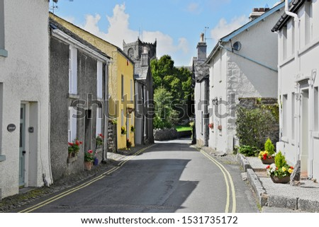 A view along Priest Lane looking towards Cartmel Priory, in the Village of Cartmel, in the county of Lancashire, England, on a sunny summers day. Stock photo ©