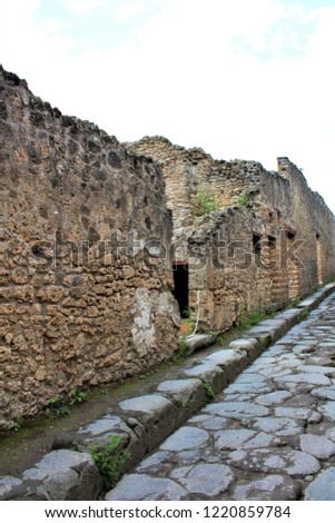 A view along the remains of a street in the ancient city of Pompeii, Italy, that was destroyed by the eruption of Mount Vesuvius volcano in 79AD.