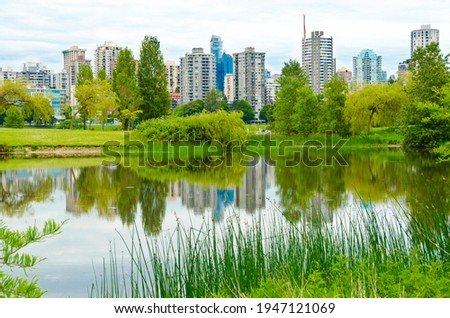 A view at Downtown and it's reflection in water of padle in Vancouver, Canada from Portside Park. Stock fotó ©
