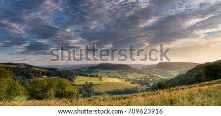 A view at sunrise across Gower Dale towards Coomb hill on a summers day.