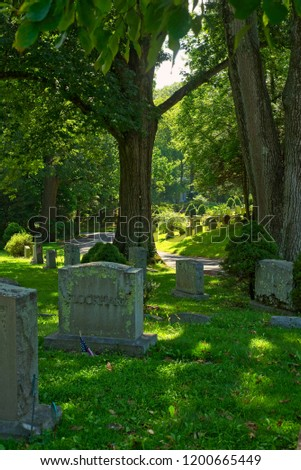 A view down a lane in the ancient and historic cemetery at Sleepy Hollow New York