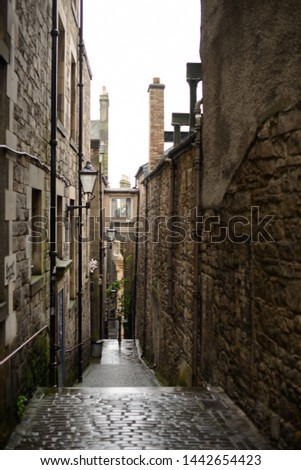 A view down Anchor Close, a small cobbled alley off the Royal Mile in Edinburgh.