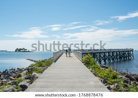 A view down the pier boardwalk on a beautiful summer day by the Long Island Sound at Calf Pasture Beach in Norwalk, Connecticut USA Сток-фото ©