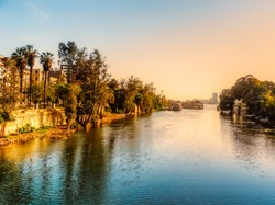 A view for the river Nile in the golden hour taken from El Manial district of Cairo, located on Rhoda Island in the Nile.
