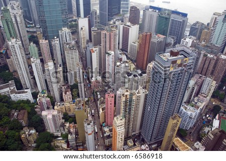 a view from a skyscraper of the busy city of Wan Chai Hong Kong