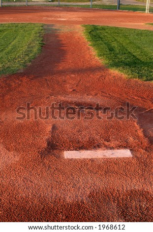 A view from directly behind a pitchers mound.