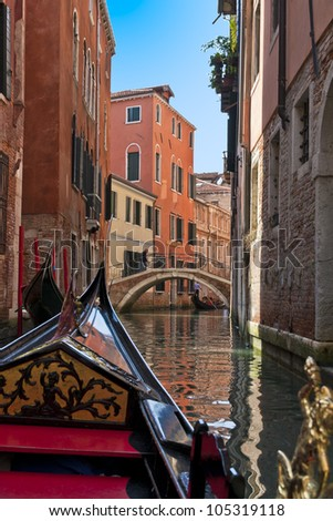 A view from gondola during the ride through the canals of Venice in Italy