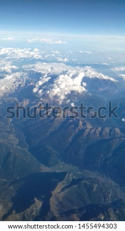 A view from the airplane, mountains  #1455494303
