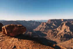a view from the top of Grand Canyon to Colorado river at sunset