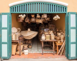 A view in front of an old shop in Thailand. It has all rattan products in Thai culture.