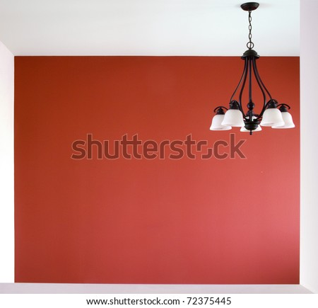 A view into a room with one red wall.