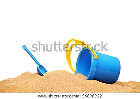 A view of a basket and scoop at the beach isolated on white background