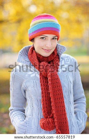 A view of a beautiful young woman in autumn park