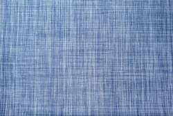 A view of a blue colored abstract criss cross woven design, as a background.